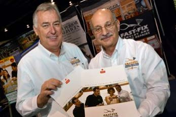 Two smiling men holding Fast-Fix brochures