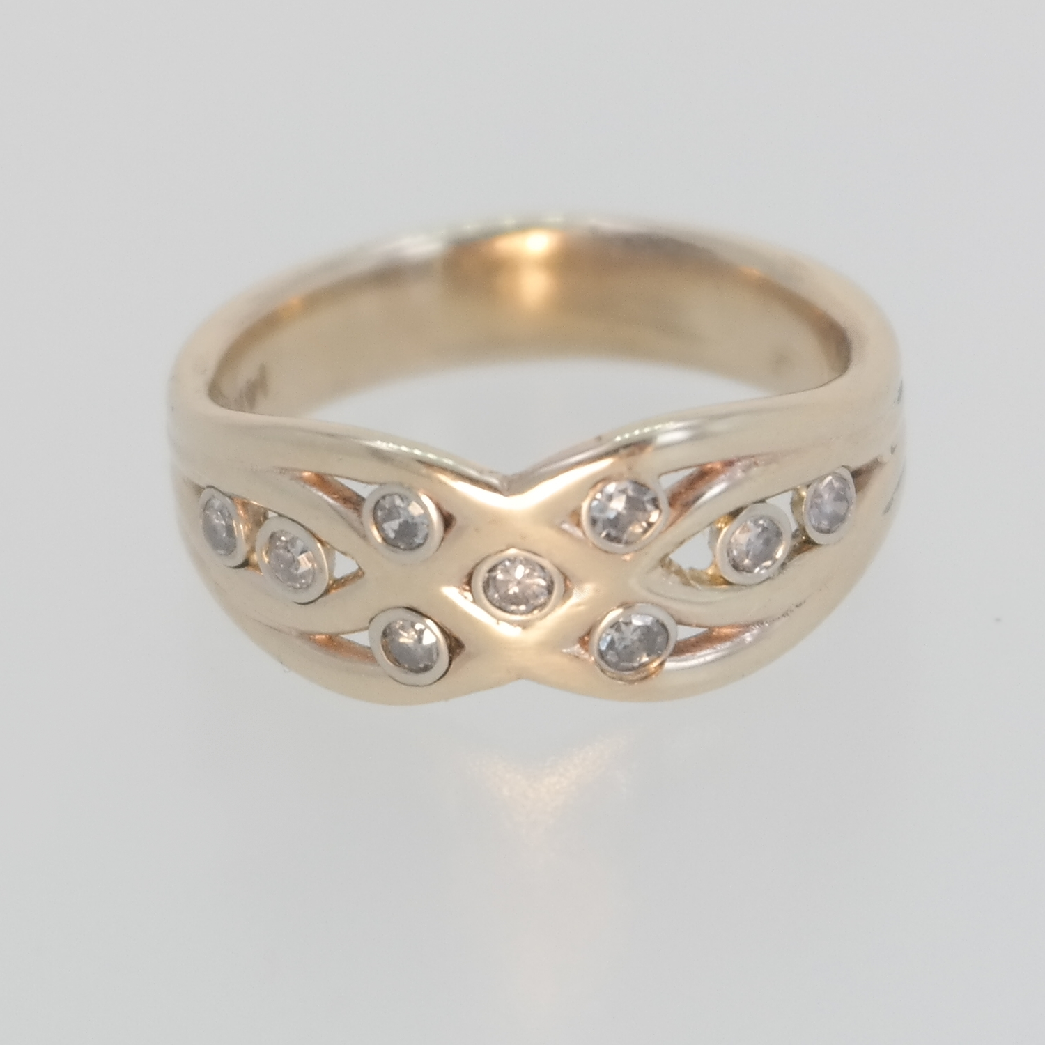 Gold ring with 9 diamonds in it