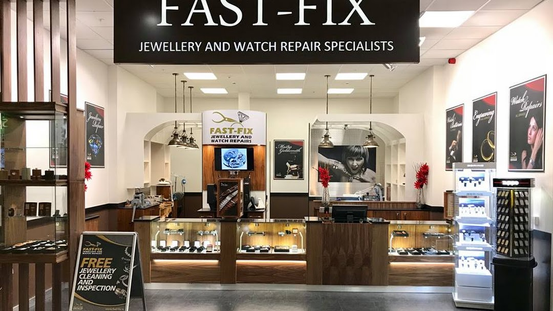 Fast-Fix Store front at Blanchardstown Centre. Shows Fast-Fix Jewelry and Watch repair specialists sign in black background and white letters. Wooden and glass sales and display stands