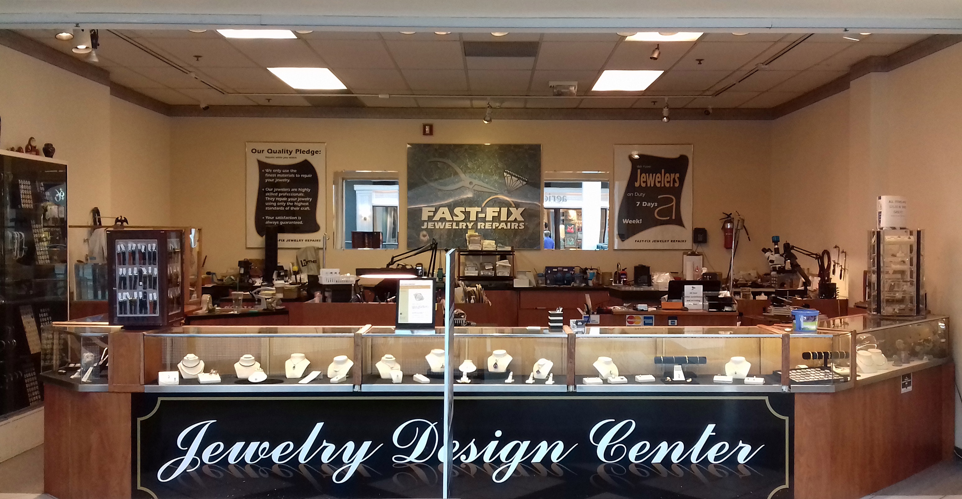 Interior of a Fast-Fix franchise store with jewelry counter on display
