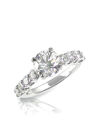 Engagement ring with diamond centre stone and smaller diamonds around the band
